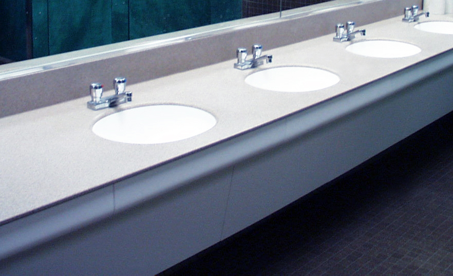 ASST Modular Vanity™ System - ADA compliant, nonporous, stain resistant solid surface vanity system for hospital restrooms, university restrooms, and other high-traffic public restrooms.