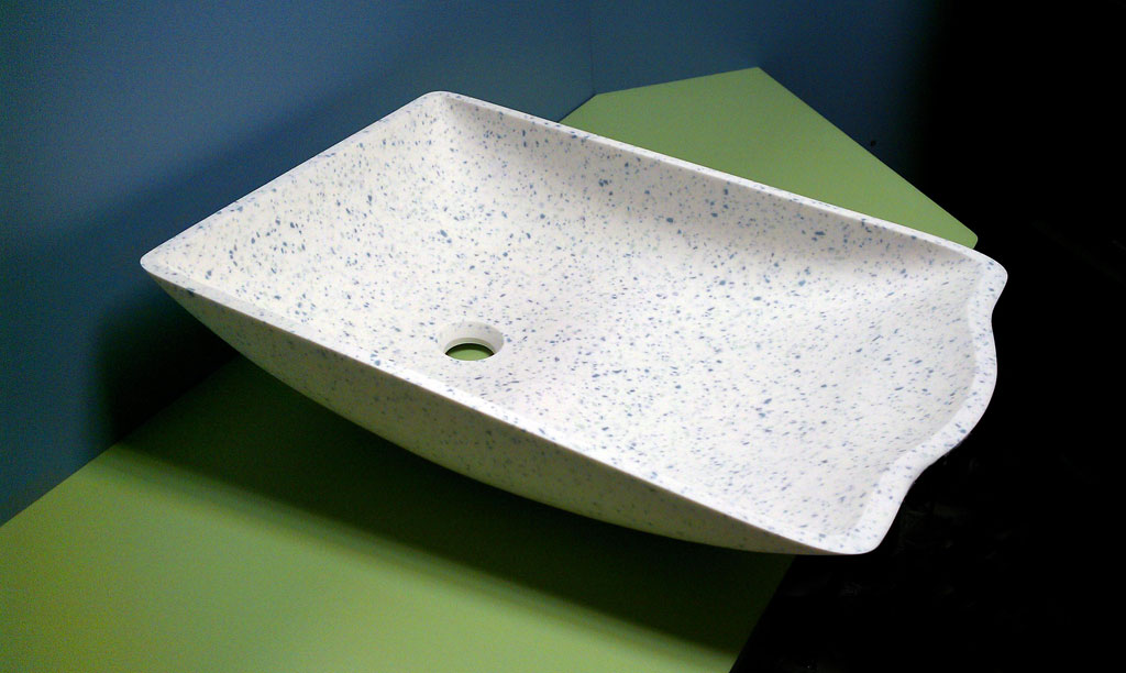 ASST Cradle™ Baby Bowl, with seamless solid surface design for hospital labor and delivery rooms. Available in Corian, LG HI-MACS, and other solid surface brands.