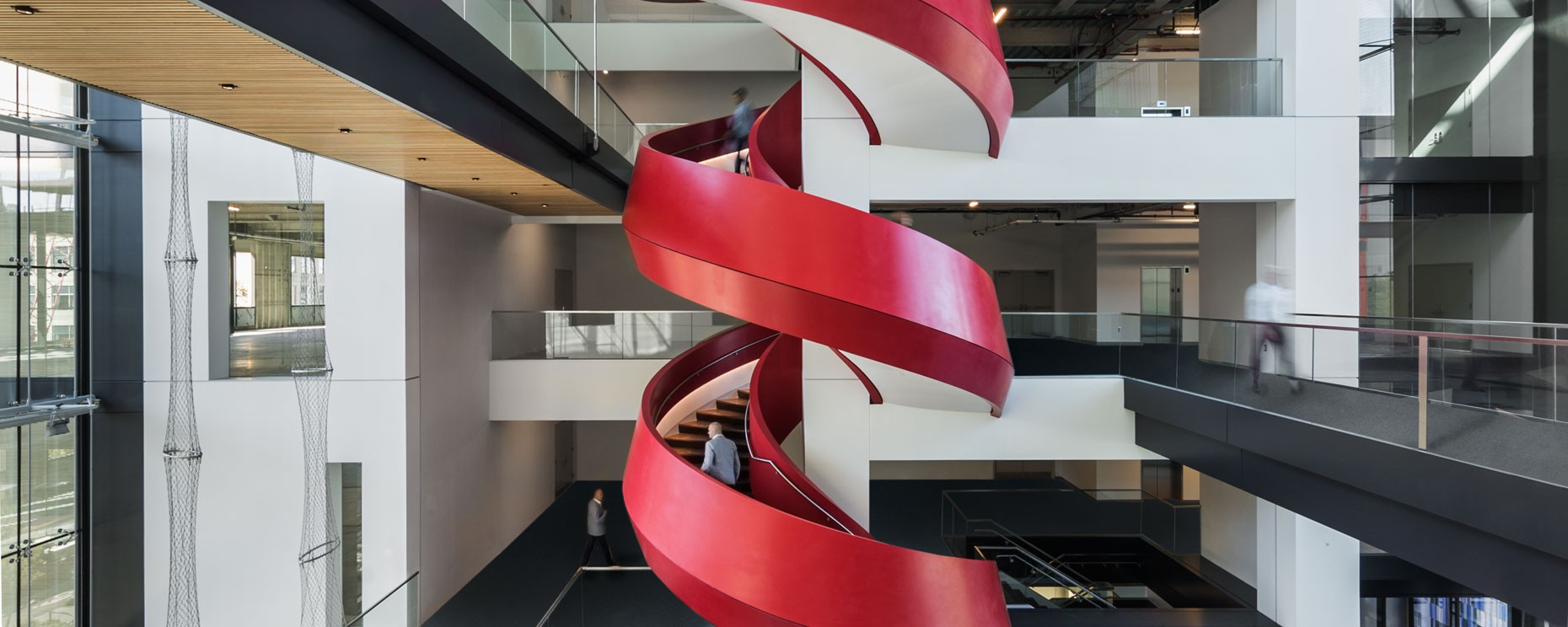 Ariad Pharmaceuticals, 75/125 Binney Street, Boston. Thermoformed solid surface spiral staircase with compound angles
