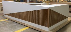 Information desk built with a combination of solid surface and bamboo materials