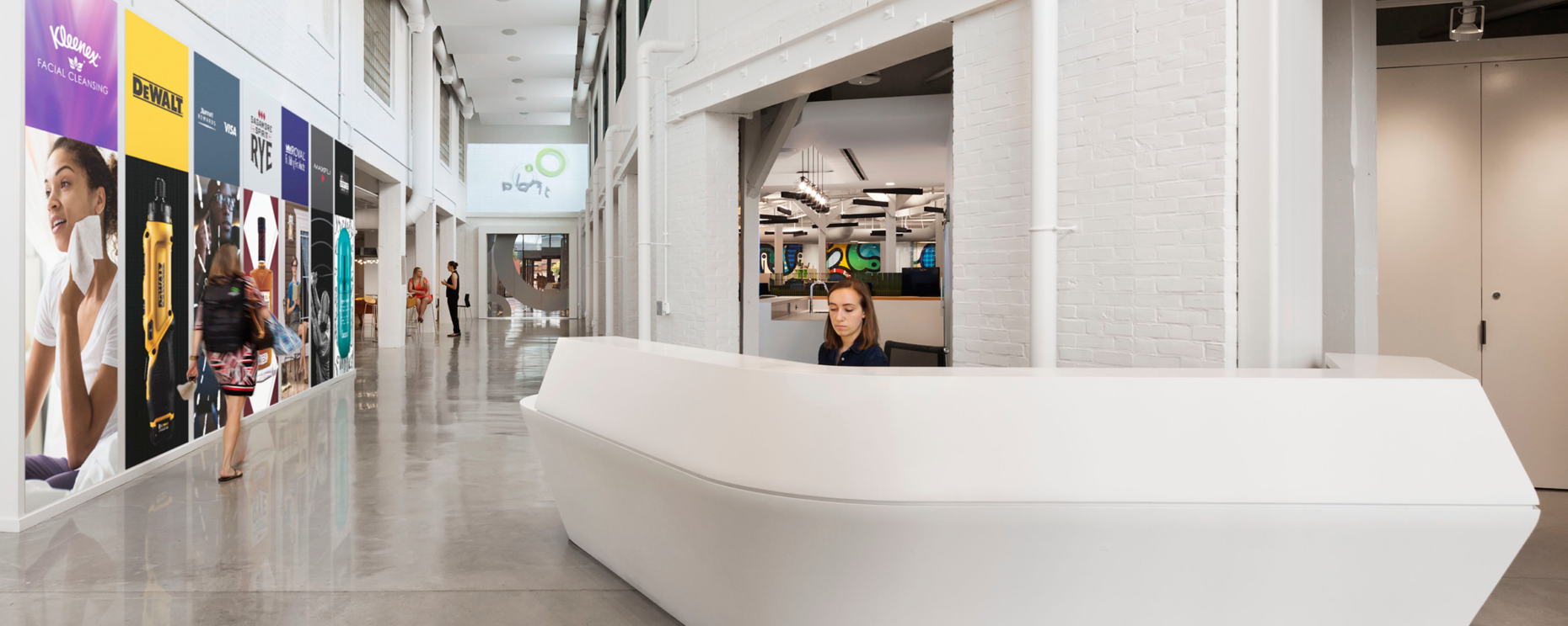 Planit Agency, Baltimore, MD. Durasein Arctic White Custom Thermoformed Reception Desk