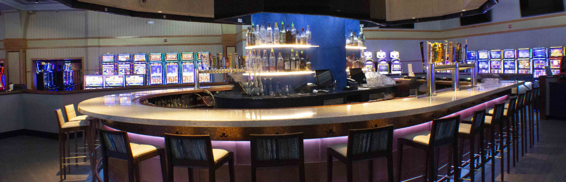 Saratogo Casino, Saratogo Springs, NY. Custom Quartz Bar  Material: Wilsonart Ascent General Contractor: Consigli